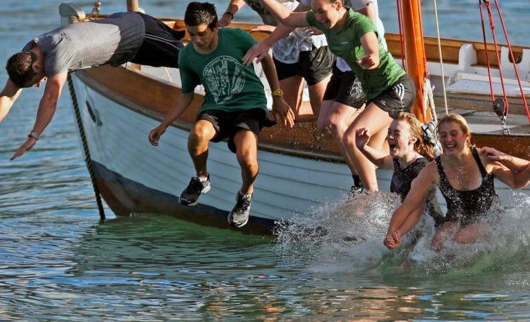 jumping into water sailing