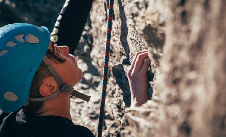 Boy-climbing-rock-